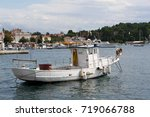 a small fishing boat in small... | Shutterstock . vector #719066788