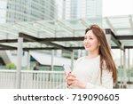 beautiful young asian woman who ... | Shutterstock . vector #719090605