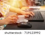 woman hand holdding coffee cup...   Shutterstock . vector #719123992