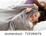 smiling woman tries to wake up...   Shutterstock . vector #719184676