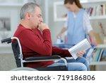 smart disabled guy spending his ... | Shutterstock . vector #719186806