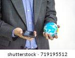 business man wiht earth globe ... | Shutterstock . vector #719195512