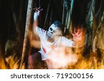 halloween. scary man in the... | Shutterstock . vector #719200156