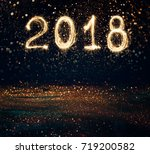 2018 written with sparkle... | Shutterstock . vector #719200582