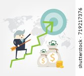 business man hold arrow to... | Shutterstock .eps vector #719217376