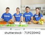 team of teen volunteers ready... | Shutterstock . vector #719220442