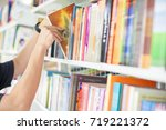 men are reading books in the... | Shutterstock . vector #719221372