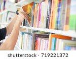 men are reading books in the... | Shutterstock . vector #719221372