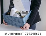 business woman carrying packing ... | Shutterstock . vector #719245636