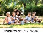 group of children sitting on... | Shutterstock . vector #719249002