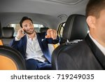 handsome man talking on phone... | Shutterstock . vector #719249035
