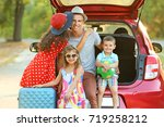 happy family next to car in... | Shutterstock . vector #719258212
