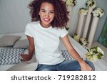 curly haired girl with freckles ... | Shutterstock . vector #719282812