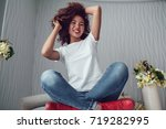 curly haired girl with freckles ... | Shutterstock . vector #719282995