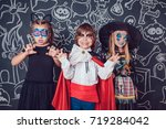 children in scary halloween... | Shutterstock . vector #719284042