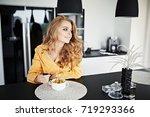 pretty girl is drinking coffee...   Shutterstock . vector #719293366