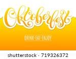 oktoberfest lettering on beer...   Shutterstock .eps vector #719326372