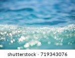 sea waves  sunlight reflection... | Shutterstock . vector #719343076
