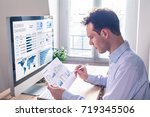 businessman working with... | Shutterstock . vector #719345506