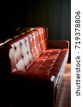 Small photo of Beautiful claret vintage leather sofa