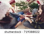 friends preparing gifts for... | Shutterstock . vector #719388022
