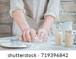 men's hands knead the dough for ... | Shutterstock . vector #719396842
