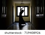 elegant woman dancing in a dark ... | Shutterstock . vector #719408926