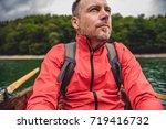 man wearing red jacket enjoying ... | Shutterstock . vector #719416732
