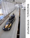 Small photo of LAKE PLACID, NY, USA - MAR. 20, 2011: Bobsled at Mt. Van Hoevenberg Olympic Bobsled Run of Olympic Sports Complex. Lake Placid hosted 1932 and 1980 Winter Olympic Games, Adirondack Mountains.