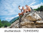hiker couple with small yellow... | Shutterstock . vector #719455492