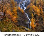 yellow larch and waterfalls in... | Shutterstock . vector #719459122
