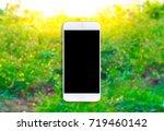 smartphone on tree blurry... | Shutterstock . vector #719460142