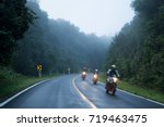 motorcycle on foggy road in... | Shutterstock . vector #719463475