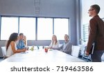 young speaker on a business... | Shutterstock . vector #719463586
