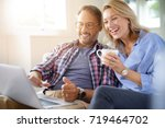 mature couple connected on... | Shutterstock . vector #719464702
