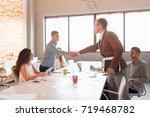 business partnership meeting... | Shutterstock . vector #719468782