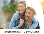 man giving piggyback ride to... | Shutterstock . vector #719470855