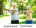 senior couple exercising in... | Shutterstock . vector #719492062