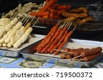 Sausages and some processed foods are pecked with skewers and served. - stock photo