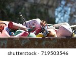 pink objects in a dumpster | Shutterstock . vector #719503546