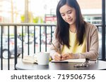 asian woman working on document ... | Shutterstock . vector #719506756