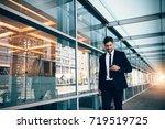 happy young businessman walking ...   Shutterstock . vector #719519725