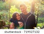 beautiful guy and girl hugging... | Shutterstock . vector #719527132