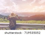 woman traveler with backpack... | Shutterstock . vector #719535052
