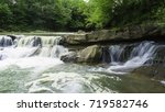 waterfall in a mountain forest | Shutterstock . vector #719582746