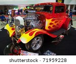 DETROIT - FEB 25: A classic hot rod with flame paint job at the Autorama Show February 25th, 2011 in Detroit, Michigan. - stock photo