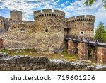 two towers in front of the old... | Shutterstock . vector #719601256
