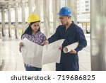 engineerwoman and worker with... | Shutterstock . vector #719686825