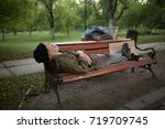 view of old man lying on bench... | Shutterstock . vector #719709745