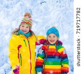 children play in snowy forest.... | Shutterstock . vector #719717782